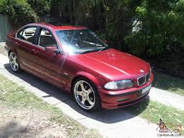 red bmw e46 323i e46 1999 4d sedan 5 sp automatic stept 2 5l multi point f inj