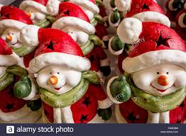 snowmen ornaments in lined up for sale at a