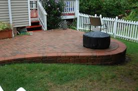 Making A Paver Patio by This Low Retaining Wall Adds More Interest To This Yard With A