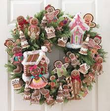 this wreath is decorated with gingerbread ornaments from