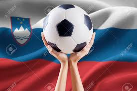 Flag Of Slovenia Image Of Two Arms Holding A Soccer Ball With National Flag
