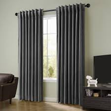 living room grey velvet curtains with brown wooden floor and