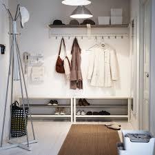 create organised calm in an all white hallway