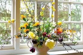 creation of a wild garden style spring floral arrangement fierce