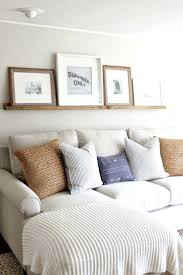 Behind The Design Living Room Decorating Ideas Wall Decor Love The Look Of The Table Behind The Couch Against