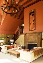 mexican style living room with high ceiling and white couches and