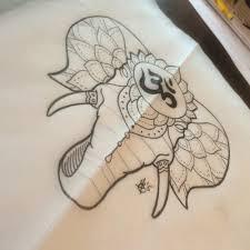 lace hamsa with buddhist sign elephant tattoo design