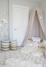 charming dusty pink kids bed canopy in a scandinavian bedroom with charming dusty pink kids bed canopy in a scandinavian bedroom with woven baskets and area rug