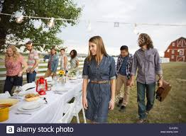 friends gathering for an outdoor dinner party stock photo royalty