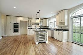white kitchen cabinets wood floors open plan kitchen with antique cabinets wood floors and
