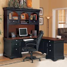 l shape black wooden table with triple brown hutch and counter top