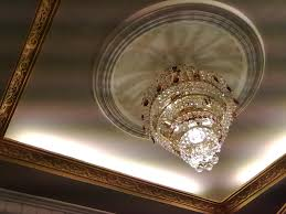 exotic pop ceiling design with exclusive chandelier and cove