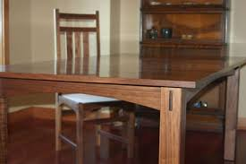 custom made walnut dining table and chairs by canton studio
