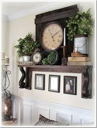 mantle decor decorating a mantle shelf the crafty frugalista