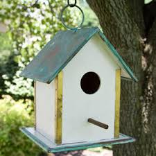 legacy hanging bird house with verde copper roof white bird