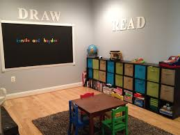playroom with cube storage bins and magnetic chalkboard kids