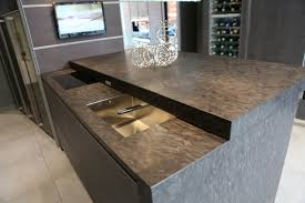 sliding worktop with hidden sink and hob creates breakfast bar