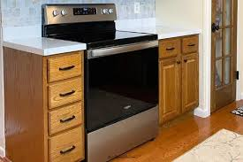 how to modernize honey oak cabinets updating wood kitchen cabinets remodeled
