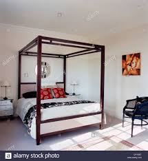 Black Poster Bed A Modern White Bedroom With Four Poster Bed Silver Chest Of