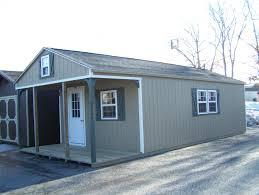 14x32 white deer peak style cabin with 6 u0027 porch pine creek
