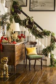green garland winding up the stair rail is decked with