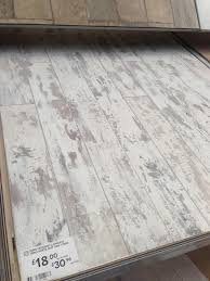 laminate flooring planks and on white distressed wood