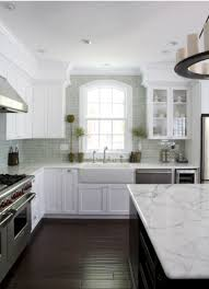 kitchen renovation on a budget subway tiles dark counters and
