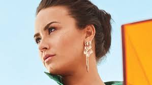 demi lovato earrings demi lovato s favorite go to snack is only 2 instyle