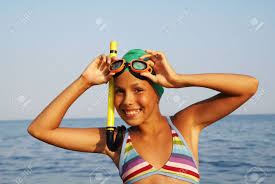 nina preteen model preteen girl in diving outfit enjoying sun bath on sea beach stock