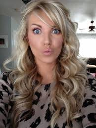 dark hair with light highlights underneath bleach blonde hair with