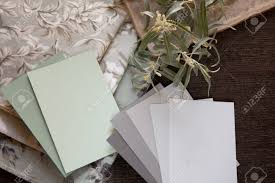 light green and neutral gray paint color and fabric swatches