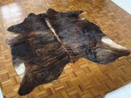 dark brown black and white cowhide rug brindle the lounge about