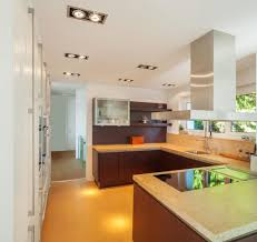 60 ultra modern custom kitchen designs part 1 bright toned kitchen is flush with yellow flooring beige marble countertops natural dark wood