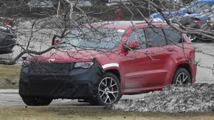 camo jeep cherokee jeep grand cherokee trackhawk spied with a new front fascia
