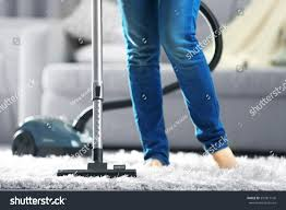 woman cleaning carpet vacuum cleaner living stock photo 397817146