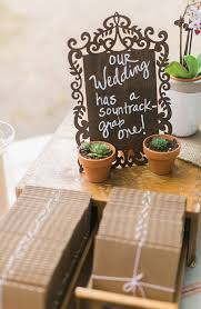 casual bed and breakfast wedding succulent favors soundtrack and favors