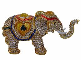 bejeweled elephant statue with trunk up