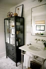 bathroom linen cabinet with glass doors glass door linen cabinet cottage bathroom h2 design and build