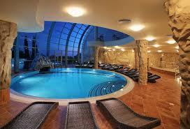 indoor swimming pool design plain wall paint closed tiny windows