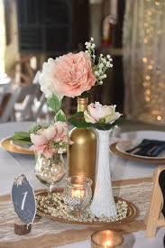 black and gold centerpieces for tables vintage elegant centerpiece milk glass gold wine bottle pearls