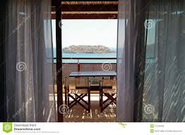 open balcony with furniture and sea view greece royalty free