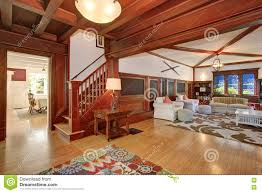 living room with vaulted ceiling luxury living room interior with wooden walls hardwood floor and