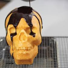 pouring chocolate glacage on my skull cake oc 1000x1000 rebrn com
