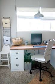 a farmhouse inspired office for two the taylored home by we decided to put his desk against the stikwood wall because it felt more masculine while her desk was closest to her craft supplies in the closet