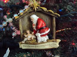 santa kneeling at the manger santa by the manger debbrammer