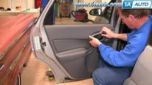 how to install replace remove rear inside door panel ford focus 00
