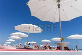 Beach Umbrella And Chairs Many White Beach Umbrellas And Chairs On Rimini Beach Italy Stock