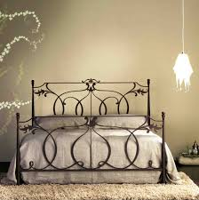 luxury wrought iron beds with dark bed cover and beautiful wall