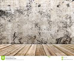 concrete wall and wooden floor in a grunge style royalty free