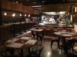 et sa cuisine vue sur le restaurant et sa cuisine centrale ouverte picture of